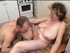 Busty mom gets a group orgy..