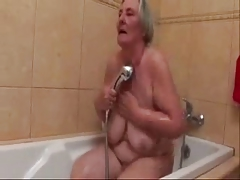 Watch this old slut taking a..